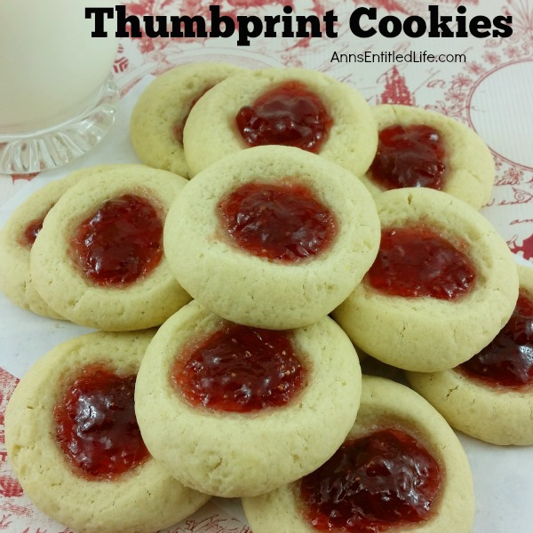 Thumbprint Cookies Recipe. A classic holiday cookie recipe, these Thumbprint cookies are easy to make. Buttery rich, jam sweet, these classic thumbprint cookies are melt in your mouth delicious.