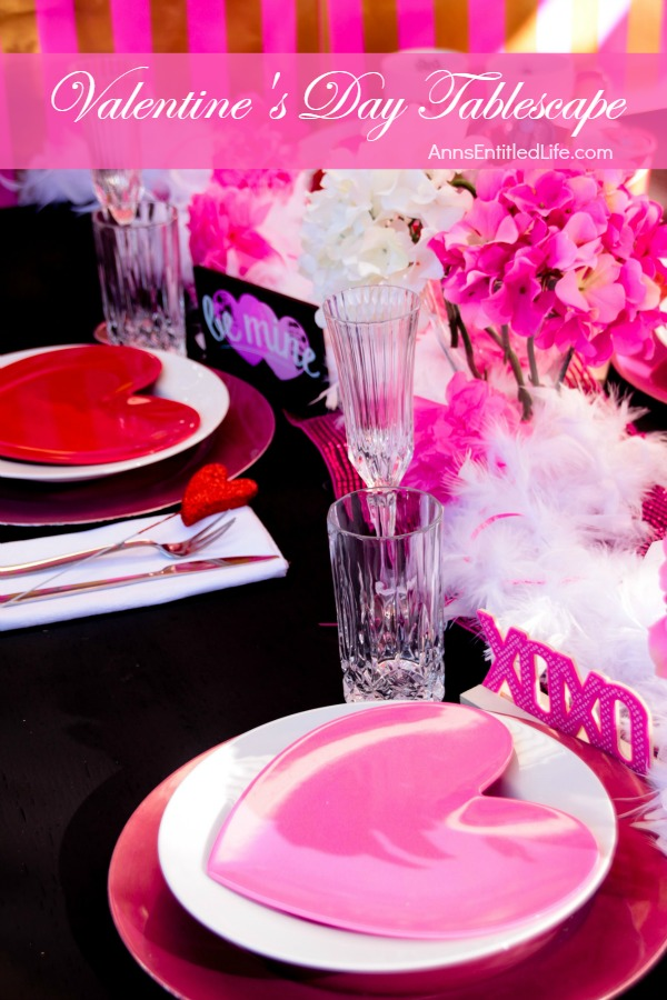 Valentine's Day Tablescape. Hosting a Valentine's Day Dinner? Dressing up the table for Valentine's Day?  This beautiful Valentine holiday tablescape features white, red and pink. A lovely bold theme to compliment your delicious dinner.