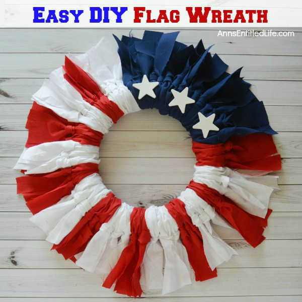 Easy DIY Flag Wreath. Make your own no sew Flag Wreath using these easy step by step instructions. This cute patriotic decor is perfect for Memorial Day, Independence Day, or any day! Simple and inexpensive to make, this Easy DIY Flag Wreath will add a marvelous touch of whimsy to you holiday decor.