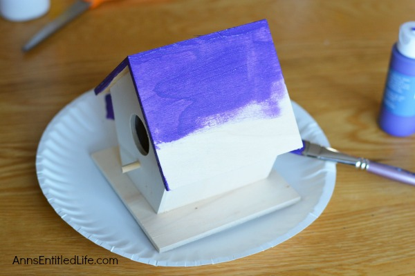 Decoupage Birdhouse. Take a plain box birdhouse and make it a real showpiece with this easy decoupage birdhouse craft!