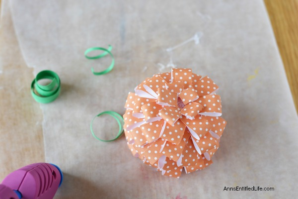 Paper Pumpkin Craft. This sweet little Paper Pumpkin Craft is perfect for autumn decor! Make one, make three, make a dozen; the more the merrier and they are easy to fabricate. Whether looking for mantel or tablescape decorations or just a whimsical adornment for a side table or windowsill, this simple to make Paper Pumpkin Craft is a great addition to your fall decorating scheme.