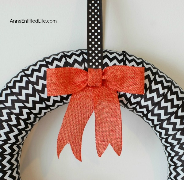 BOO-Tiful Halloween Wreath. While this beautiful DIY Halloween Wreath will not scare anyone, it is lovely and stylish Halloween decor. Hang this Halloween wreath on your front door, side door, over a mantel - anywhere you place seasonal wreath decor. These easy to follow step by step instruction tutorial will have you completing this BOO-Tiful Halloween Wreath in no time flat!