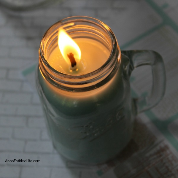 Homemade Mason Jar Soy Candle. Easily and inexpensively make your own Homemade Mason Jar Soy Candle! This is great for gifts or to scent your own home anytime of the year. Easily customize these candles to any color you like. This Homemade Mason Jar Soy Candle is a fun DIY project that yields great results!