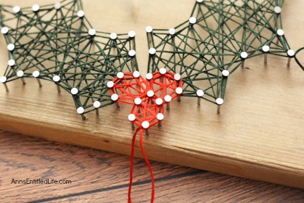 Holly Berry String Art. Make your own beautiful Holly Berry String Art with this step by step tutorial. Included are the printable patterns, easy to follow directions and tutorial photographs so you can make this lovely Christmas craft yourself. Keep for yourself, or give as a gift!