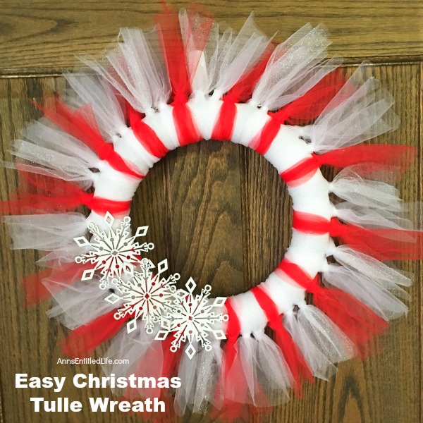 Easy Christmas Tulle Wreath. Update your holiday decor and make this Easy Christmas Tulle Wreath! Simple to make, this tulle wreath can be customized to any color to match your holiday decor.