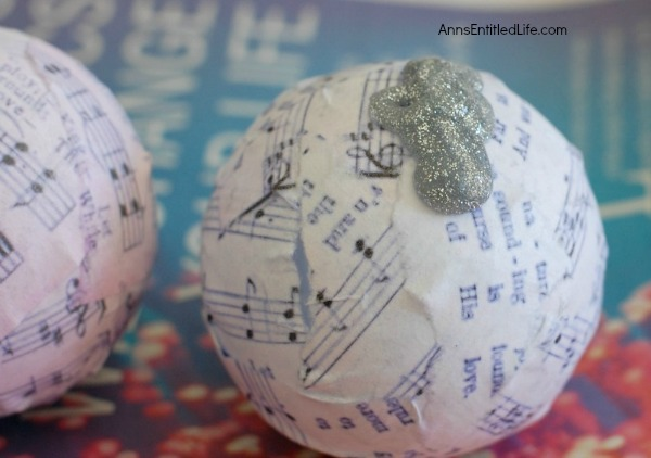 Joy Decoupage Christmas Ornament. Make your own decoupage Christmas Ornament. This easy step by step tutorial for a Joy Decoupage Christmas Ornament results in a beautiful handmade ornament that you can hang on your tree, or give as a gift. This DIY project is so easy, nearly anyone can do it!