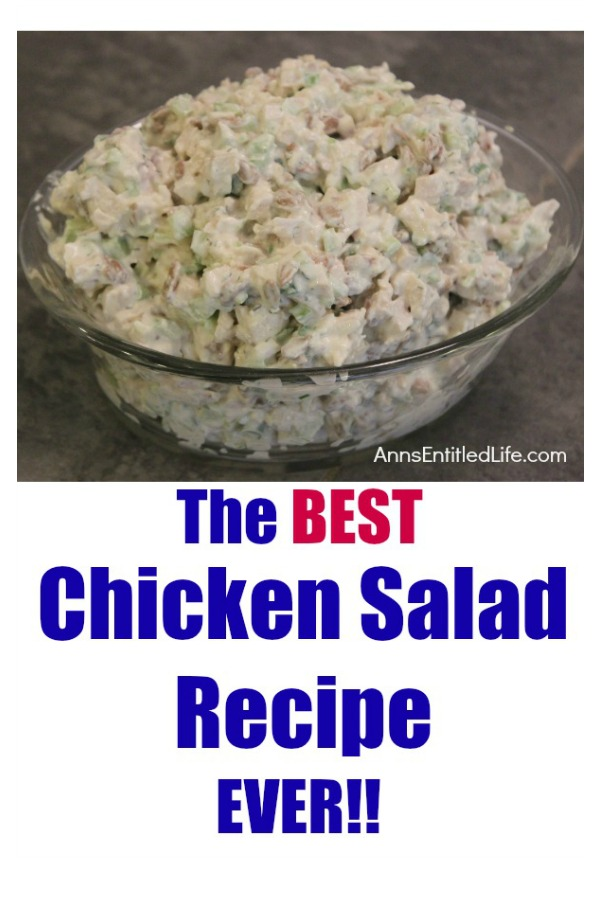 chicken salad in a glass serving bowl on top of a graey slate kitchen island