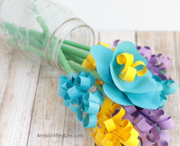 Handmade Paper Flower Bouquet. An easy step by step tutorial on how to make paper flowers at home. Learn to make a beautiful handmade paper flower bouquet today!