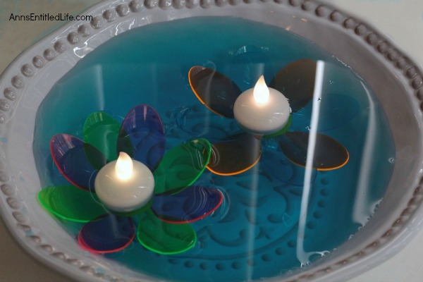 DIY Floating Spoon Flowers. Make your own floating flowers from plastic spoons! These simple to make floating flowers would be perfect to use at a wedding, summer party, in a backyard pool, or to light up in your backyard pond.