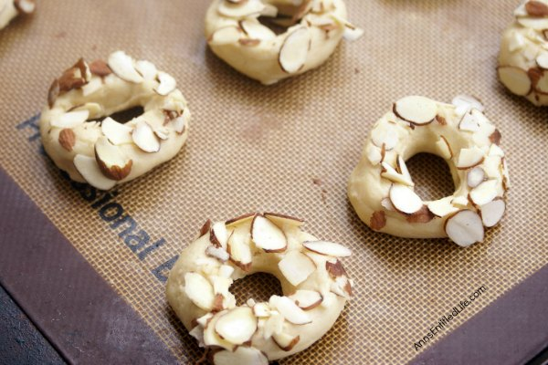 Almond Doughnut Cookies Recipe. Fun, easy to make cookies in the shape of a doughnut! These cookies are wonderful for packing in the old lunchbox, dessert or a cookie exchange!