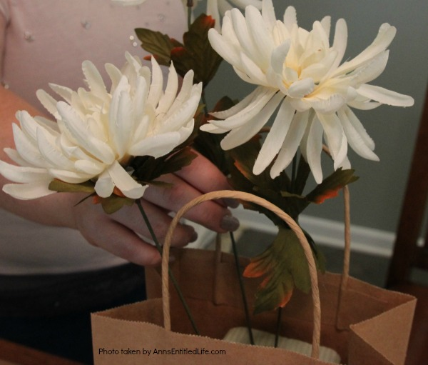 Dollar Store Craft: Paper Bag Flower Arrangement. This is an unusual, easy to make craft you can fabricate with basics found at your local dollar store. If you are looking for an inexpensive, quirky craft, you can make this paper bag flower arrangement in about 30 minutes using these step-by-step instructions.
