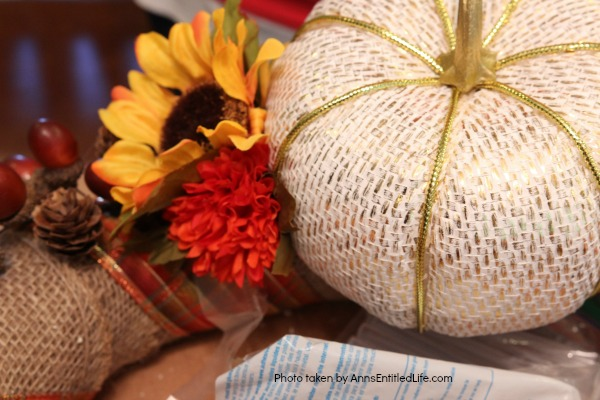 Rustic Fall Burlap Wreath DIY. This DIY tutorial on how to make a Rustic Fall Burlap Wreath has easy to follow, step-by-step instructions. Less than an hour or so of your time results in a lovely autumn wreath that is highly customizable, and a lot less expensive than a store bought wreath! Perfect fall decor for your front door.