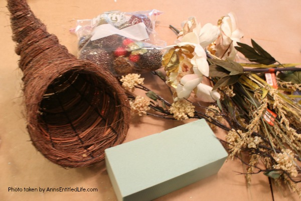 Floral Horn of Plenty DIY. This beautiful floral horn of plenty is a wonderful centerpiece or end table decorative piece, perfect for the fall season. A wonderful Thanksgiving decor accessory, this overflowing cornucopia is easy to make, and highly customizable.
