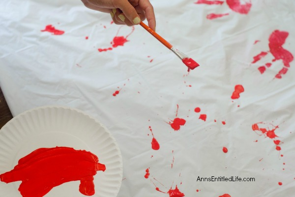 Zombie Blood Clot Tablecloth. Instead of paying big bucks for a Halloween tablecloth, make this simple Zombie tablecloth. It adds a touch of spooky to your Halloween party table. Five minutes, plus dry time, and your Halloween table has a spooktacular covering!