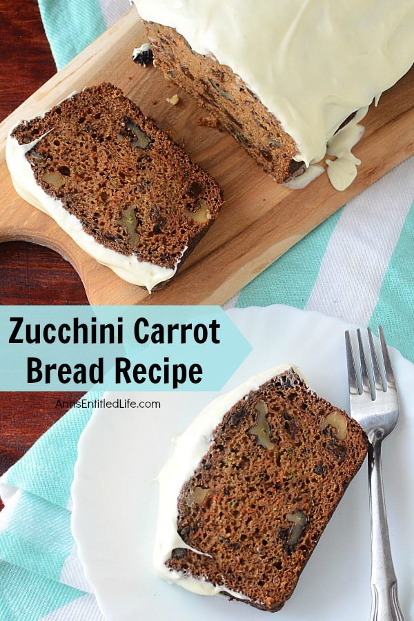frosted zucchini carrot bread on a white plate with fork, remaining loaf on a butcher block cutting board