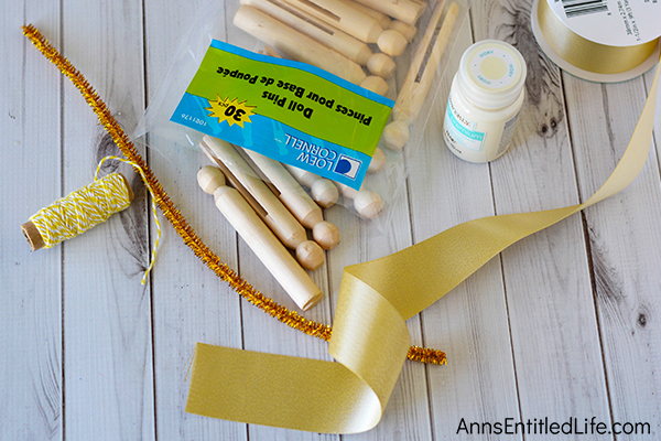 Angel Clothespin Ornament DIY. These simple to make angel ornaments are a whimsical, rustic craft nearly anyone can make. This fast craft can be customized to match your holiday decor. If you are looking for an easy to make ornament craft, this Angel Clothespin Ornament DIY is it!
