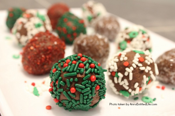 Chocolate Raspberry Truffle Bites Recipe. These simple to make chocolate truffles come with a fun raspberry surprise inside! A fun addition to your holiday cookie platter, this Chocolate Raspberry Truffle Bites Recipe is truly tasty.