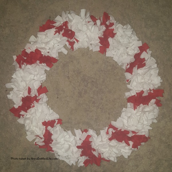 Candy Cane Wreath DIY Tutorial. Make your own no-sew Candy Cane using these easy step by step instructions. This cute holiday decor is perfect for Christmas, Valentine's Day, or any day! Simple and inexpensive to make, this easy Candy Cane Wreath DIY Tutorial will show you how to add a marvelous touch of whimsy to your holiday decor.