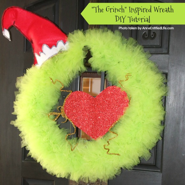 The Grinch Inspired Wreath DIY Tutorial. A beautiful Mr. Grinch inspired wreath sure to make even the coldest heart burst! This step by step tutorial is complete with (free) pdfs for the hat and heart for you to print and make exact. This wreath will look great on your front door, over your mantel, or on a wall. Truly unique holiday decor!