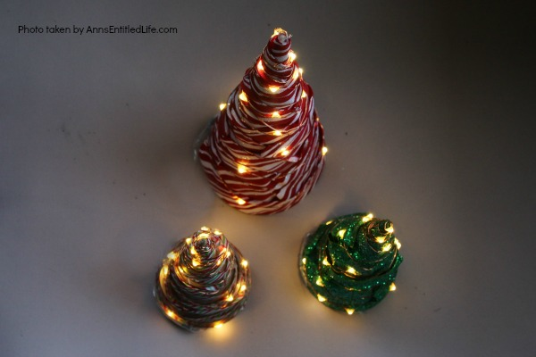 Easy Lighted Ribbon Christmas Tree. This 15 minute craft is simple to make, and highly customizable. This Easy Lighted Ribbon Christmas Tree will dress up your Christmas table, light up your mantel, or just smile as you walk by them. Only you will know how quick and easy these little trees are to put together.