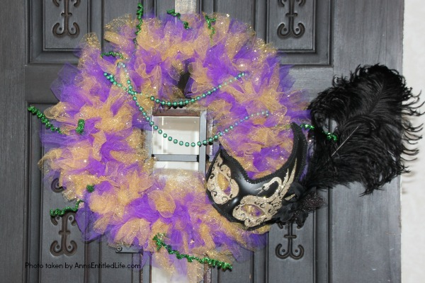 Glitter Mardi Gras Mask Wreath Tutorial. Follow the step by step instructions of this Glitter Mardi Gras Mask Wreath Tutorial to make this beautiful, sparkly, Mardi Gras Wreath. This highly customizable, simple to make, Glitter Mardi Gras Mask Wreath will look great on your front door, over your mantel, or on a wall. Truly unique Mardi Gras decor!