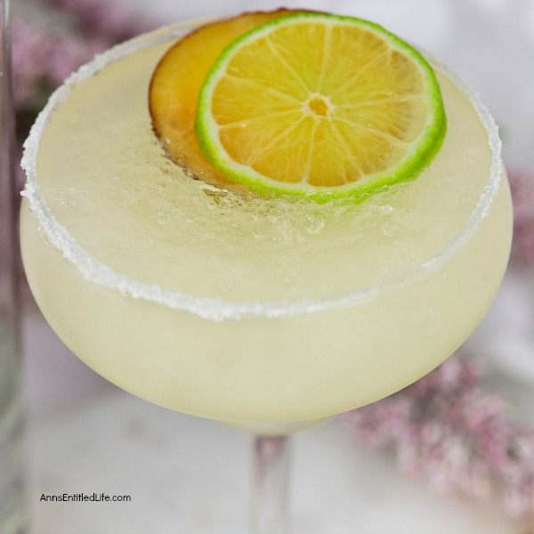 Peach Margarita Recipe. Warm summer evenings are perfectly suited to a delicious, cool libation. This Peach Margarita is just the drink for the occasion. On the rocks, this Peach Margarita Recipe is exquisitely sweet, refreshing and potent!