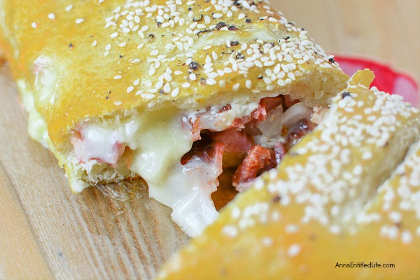 Ham and Cheese Stromboli Recipe. This delicious, easy to make, ham and cheese Stromboli is a great lunch, dinner, or party food. This can be cut into sandwich size portions for a few people, or cut into inch slices as a party food to help feed a crowd.