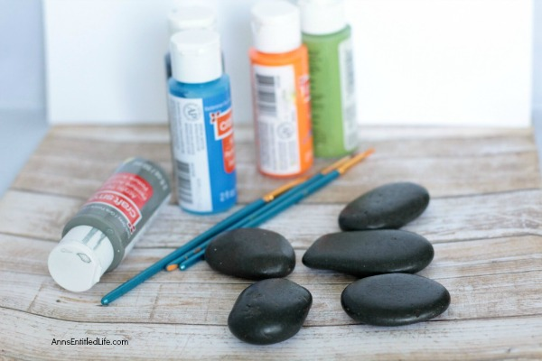 Compliment Painted Rocks. How to paint rocks. This easy painted rocks tutorial has many rock painting ideas for a beginner. Whether giving as a gift, painting rocks for the garden, or just painting a fun, decorative rock for the family room shelf, these compliment painted rocks are adorable and simple to make.