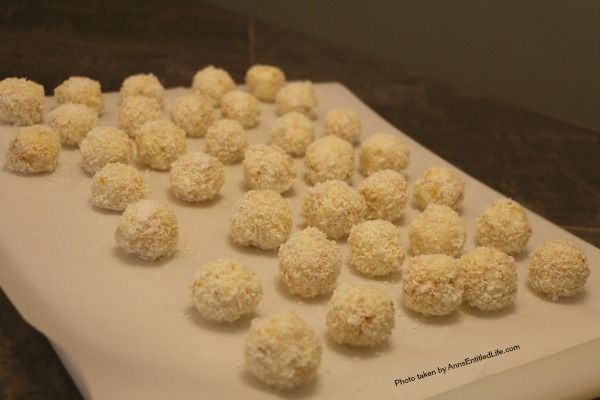 No Bake Coconut Balls Recipe. It is a cookie! It is a candy! It is two treats in one. This is an easy to make, creamy and delicious no-bake coconut ball recipe with a nutty surprise in the middle. These coconut balls are delightful sweet treat your whole family will enjoy. Yum!