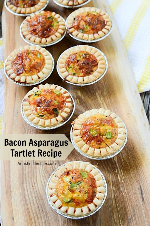 Bacon Asparagus Tartlet Recipe. Ready in no time flat, these simple to prepare Bacon Asparagus Tartlet appetizers are just what your next party needs! Whether you serve as a snack or hors d'oeuvre, this bacon asparagus tartlet recipe is a great addition to any gathering or celebration. From showers to wedding recipes to game day parties, these delicious little appetizers are sure to please your friends and family alike. Yum!