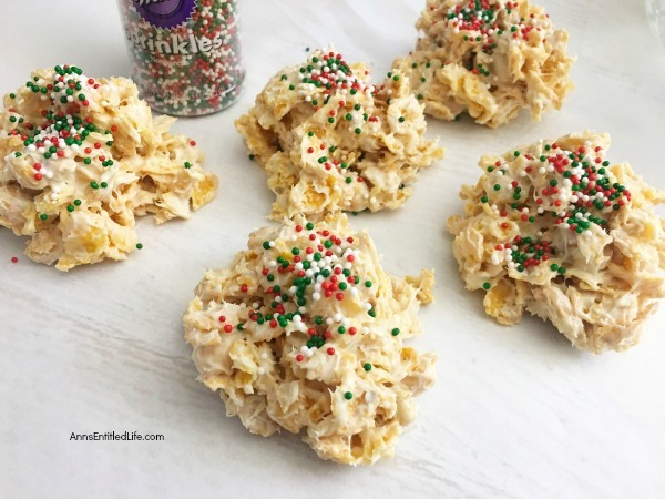 Easy Cornflakes Christmas Clusters Recipe. It is the holiday season and sometimes things are so hectic it is difficult to make time to bake or cook holiday centric-dishes. But everyone has time to make these super easy cornflake Christmas clusters. This simple 4-ingredient recipe is festive, tasty, and you can make them in about 5 minutes. These are a great tasting holiday treat your whole family will enjoy.