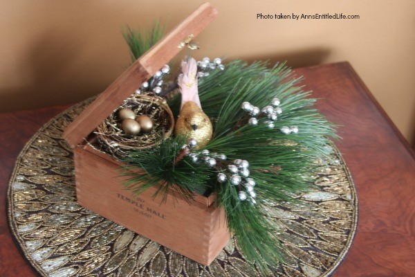 Wooden Box Bird's Nest Floral Arrangement. This adorable little birdie will look so sweet on a side table, fireplace mantel, or as part of a centerpiece! Use an old wooden box (this one is a cigar box), a bird and its nest, and in about 15 minutes you will have an unusual, but lovely, floral piece perfect in any décor!