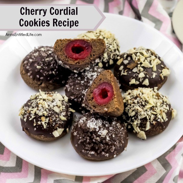 Cherry Cordial Cookies Recipe. A sinfully decadent chocolate cookie surrounds a cherry surprise in the middle! These easy to make cookies are fun and delicious. Your friends and family will love these tasty cookie treats!