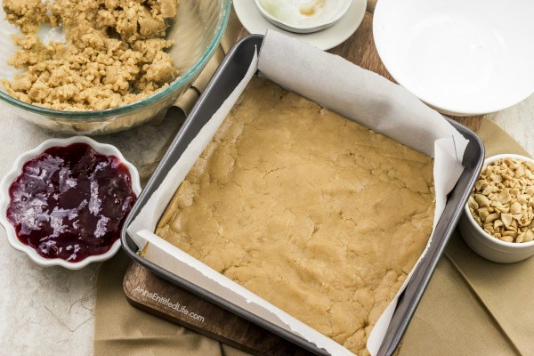 Easy Peanut Butter and Jelly Bars Recipe. If you are looking for an easy to make snack, a lunchbox sweet, or an after dinner dessert, look no further than this easy to make Peanut Butter and Jelly Bars Recipe. The great taste of old-fashioned PB&J in a delicious bar form. Your entire family will love these tasty treats!