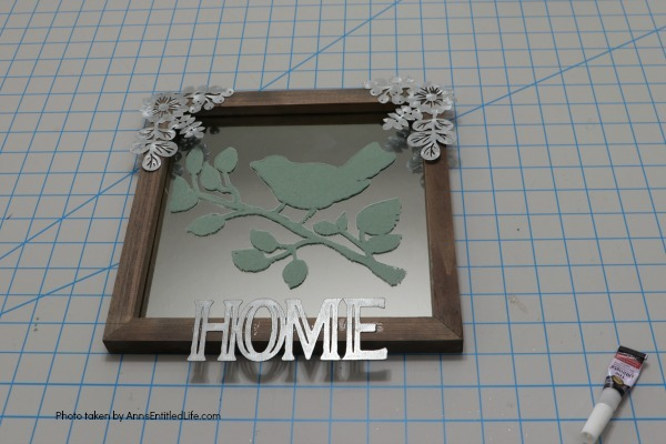 Farmhouse Décor: Easy Painted Mirror. This sweet little painted mirror is easy to make, rustic décor. Great for indoor or outdoor decorating, this DIY farmhouse style painted mirror fills in that small area of open wall space perfectly. This step-by-step tutorial will show you exactly how to make this simple painted mirror project inexpensively.