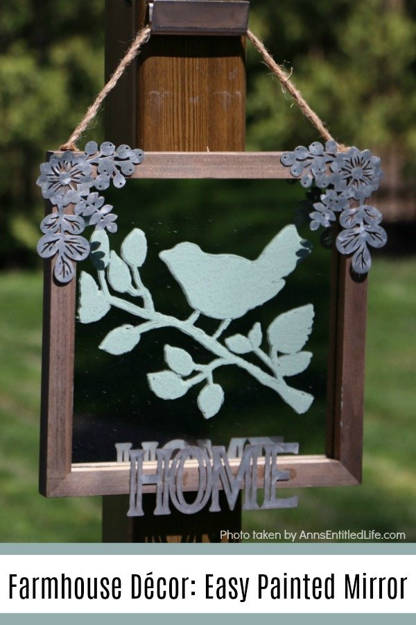 painted green bird stencil on a rustic frame mirror