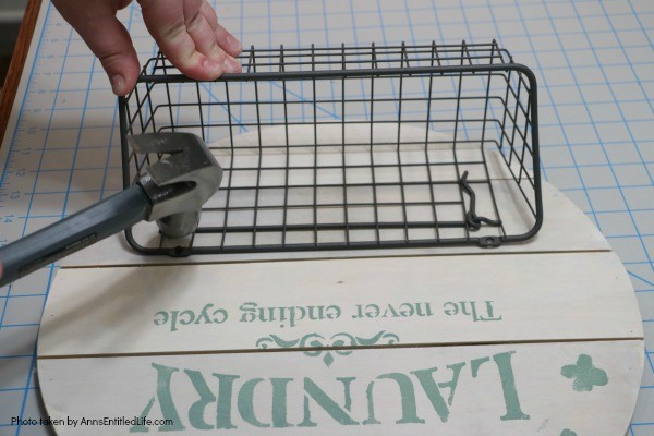 Farmhouse Décor: Laundry Room Organizer. Need to organize your laundry room? Looking for a place to store your outdoor clothesline clothespins? Make your own laundry room organizer! This adorable little DIY organizer is stylish and functional. A perfect place to keep clothespins, stain treatments, drier balls, and more, this rustic organizer is a farmhouse winner.