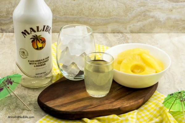 Pineapple Malibu Slushie Recipe. Mmmmm nothing beats a cold slushie on a hot summer day! This pineapple Malibu slushie cocktail is easy to make, frosty cold, and oh so delicious. Try one while sitting in the backyard, or lounging by the pool this weekend.