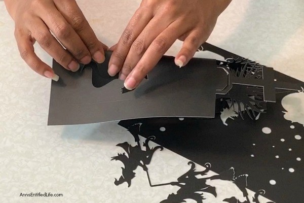 Easy Cricut Halloween Lanterns. Ghosts and Goblins and Witches, oh my! These cute little Halloween lanterns are a snap to make with your cricut machine using these step-by-step tutorial instructions. Fun in the daylight, positively eerie in the evening (when you add a flameless tea light), you can make one these Halloween lanterns for only pennies!