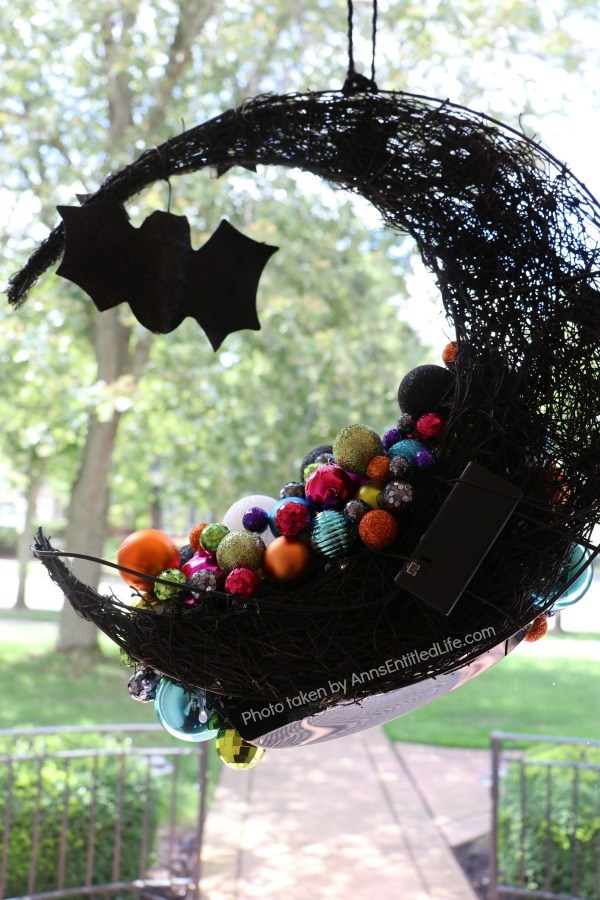 Homemade Halloween Witch's Cauldron Wreath. A step by step guide on making a halloween wreath inspired by a witch's cauldron! This easy to follow tutorial teaches you how to make a halloween witch's cauldron wreath. This wreath is perfect Halloween door decor your trick or treaters will love!