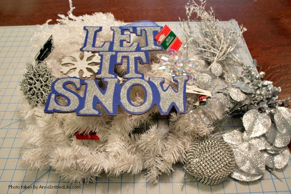 Let It Snow Wreath. This beautiful, blingy let it snow wreath is so easy to make! If you are looking for a fun and simply winter craft project to hang on your front door or over your fireplace mantel, you will want to make this sparkly winter wreath.