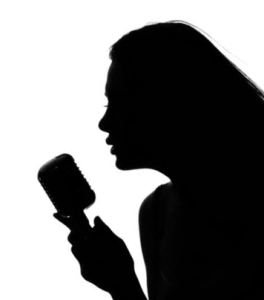 silhouette woman at mic
