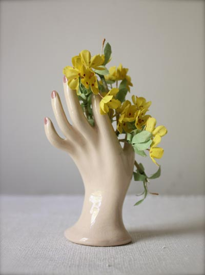 ceramic hand with flowers