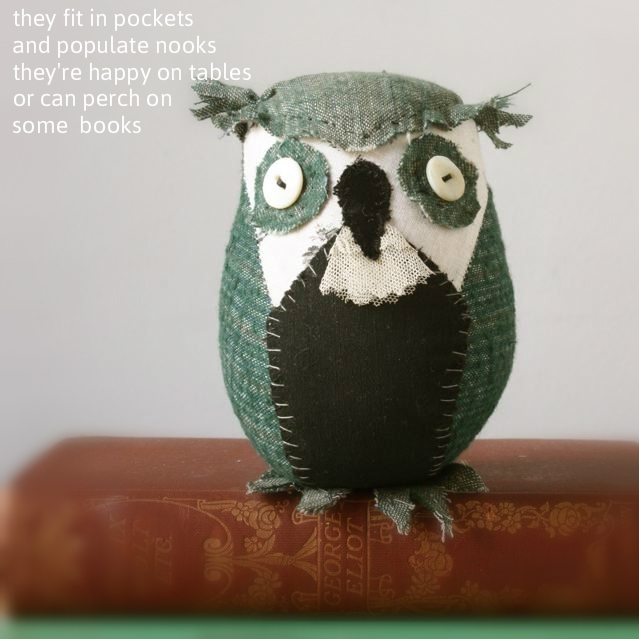 owl perched on books