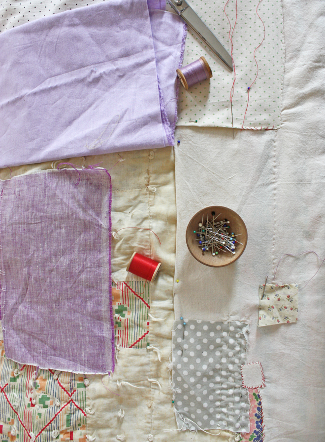 patching and mending an old quilt wabi sabi style