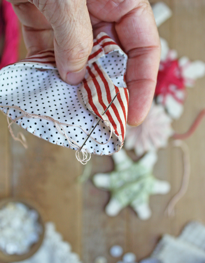 blanket stitch edging on a tiny pinafore apron