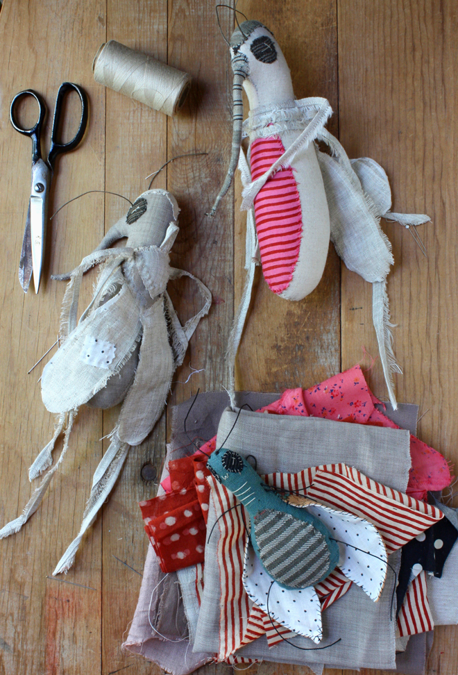 mosquito and beetle rag dolls on my worktable