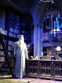 Dumbledore's office. On the top of the stairs is the first Dumbledore's costume as well. And on the back lefthand wall you can find the Sorting Hat.