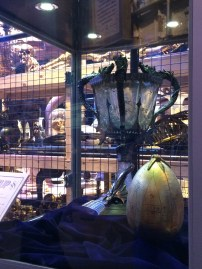 The Triwizard Cup and the golden egg. Behind them you might be able to see the cage full of miscellaneous props.