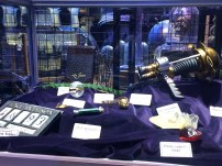 Some notable props, such as the golden snitch, Rita Skeeter's quill, and the philosopher's stone. What else can you spot?